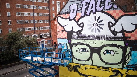D*Face working on his mural in King's Cross