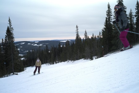 Skiers on the descent in ski resort in Trysil, Norway