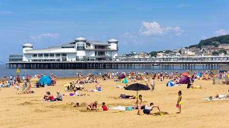 The Grand Pier and beach in Weston-super-Mare are essential stops at this British holiday destination
