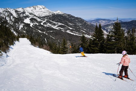 """Top of Nose Dive ski trail, Stowe Mountain Resort, Stowe, VT, USA, New England . """"Chin"""" peak, highest point in VT, in distance."""