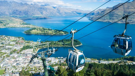 The Queenstown skyline gondola downtown overlooking Lake Wakatipu and the Remarkables mountain range