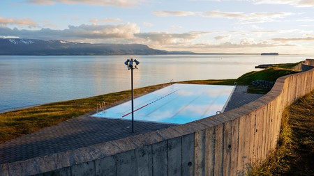 Enjoy the view from Hofsós Swimming Pool towards the ocean and the island of Drangey, Iceland