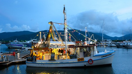 Dining options in Cairns include Prawn Star, a popular seafood restaurant on a boat