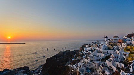 Watch the sunset over the white-washed houses of Oia, Santorini