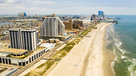 The boardwalk at Atlantic City, New Jersey, extends along the ocean coast