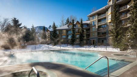 Relax in the heated pool while admiring the gorgeous scenery at the Whistler Cascade Lodge by Vacasa