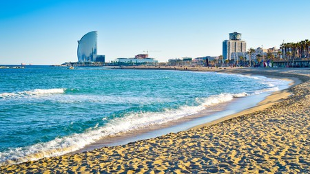 Barcelona's beaches, including La Barceloneta, are a great place to chill – with plenty of watersports on offer for the more adventurous