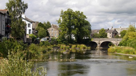 Kendal, in Cumbria, with the River Mint running through it, is a pretty spot to stay in during your Lake District holiday