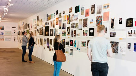 People enjoy an exhibition at the Centre for Contemporary Photography, Melbourne