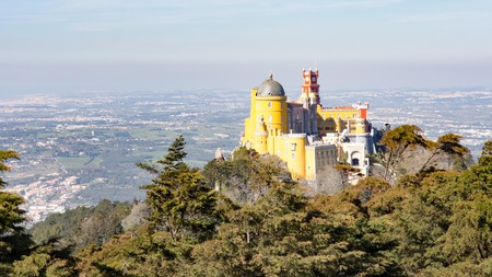 The fairytale-esque Pena Palace is one of the top places to see in Sintra, Portugal