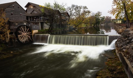 Enjoy a rustic stay and catch a glimpse of Little Pigeon River running over the weir through Pigeon Forge, Tennessee