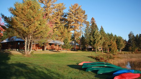Make the most of the Maine outdoors with a stay at a lodge such as Lake Parlin Lodge and Cabins on the lake