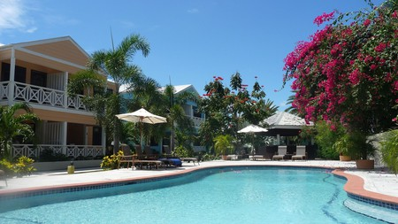 Relax in the tropical gardens of Buccaneer Beach Club
