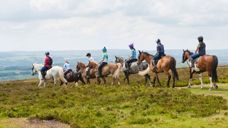 Horse riders at Dunkery Beacon in Exmoor National Park