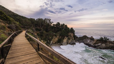 The rugged coastline of Big Sur, where towering redwood forests meet dramatic oceanside cliffs, is one of the world's most impressive natural wonders
