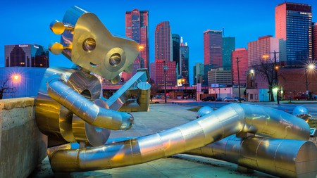 Discover unique street art like the Traveling Man on a budget-friendly trip to Dallas