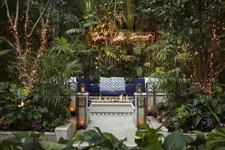The jungle-like courtyard is the centerpiece of this Four Seasons hotel