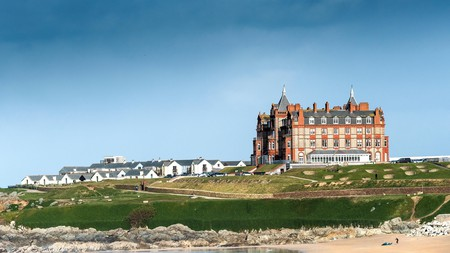 The iconic Headland Hotel overlooking Fistral Beach in Newquay in Cornwall.