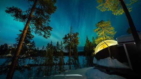 Watch the Northern Lights through your hotel room's glass ceiling