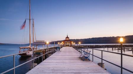 Seneca Lake pier in Watkins Glen glistening during dusk