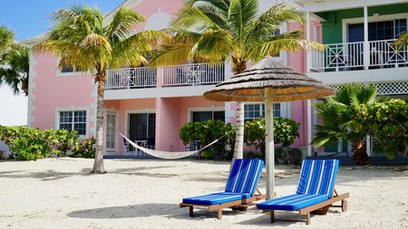 Book a villa on the Lagoon Beach at Sandyport Beach Resort, and you can step right out onto the sand