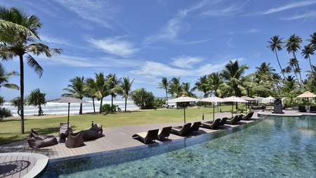 Watch the Indian Ocean waves from the comfort of a sun lounger at the Weligama Bay Marriott Resort and Spa