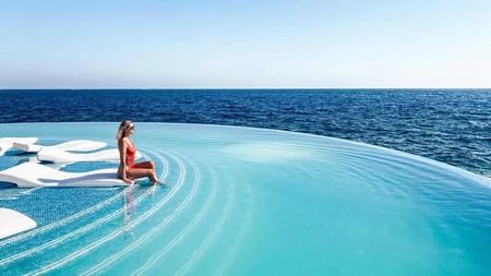Enjoy the stunning half-moon beach club pool at 1926 Hotel & Spa