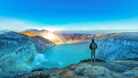 A hiker takes in the view at Kawah Ijen, Banyuwangi