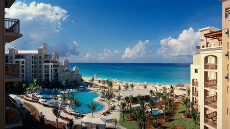 The Ritz-Carlton Grand Cayman on Seven Mile Beach is a Caribbean paradise of luxury; the lagoon pool, cabana beds on the beach, and La Prairie Spa all beckon you to come and play