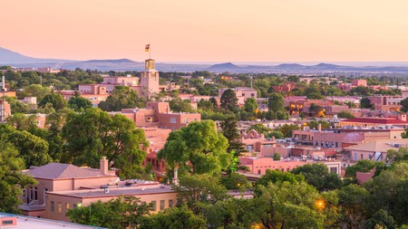 The skyline of downtown Santa Fe, New Mexico at dusk