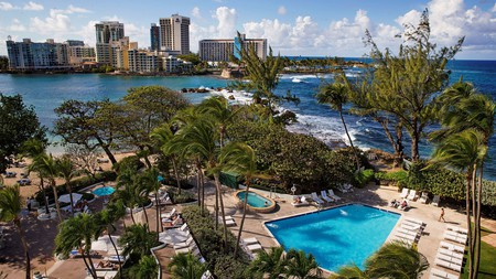 Enjoy views over the Atlantic Ocean from your private balcony at the Condado Plaza Hilton