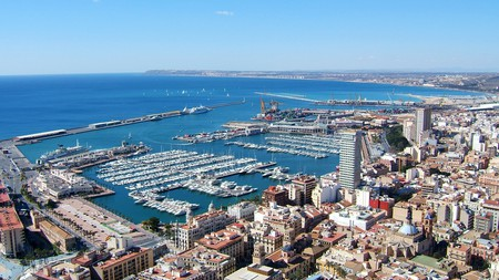 Ships dock at the port of Alicante in Valencia, Spain