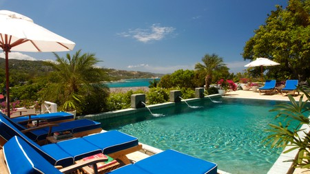 Relax by the pool at the Round Hill Hotel in Jamaica, the Caribbean