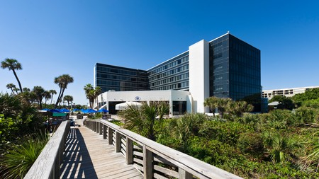 Hilton's Cocoa Beach Oceanfront hotel is all the best bits of Florida combined for your pleasure – water sports, white sand, a tiki grill, and beach bar; everything you could wish for on your Space Coast vacation