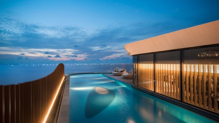Survey the city in style from an infinity pool overlooking Manila Bay