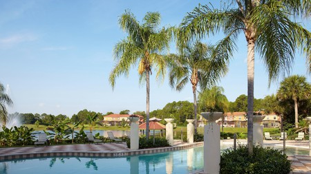 Relax poolside at Encantada Resort on a trip to Kissimmee