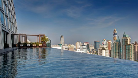 Imagine yourself relaxing by the infinity edge pool at one of Bangkok's best spa hotels, the Okura Prestige
