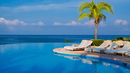 Relax by the pool at the Four Seasons in Punta Mita, Mexico