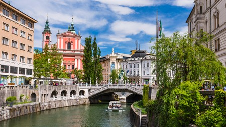 The Ljubljanica River and the Franciscan Church of the Annunciation welcome visitors to Slovenia's capital