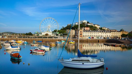 The English seaside town of Torquay is brimming with charming cafés, pretty shops and Michelin-star restaurants, alongside cliff-baked beaches and secluded bays