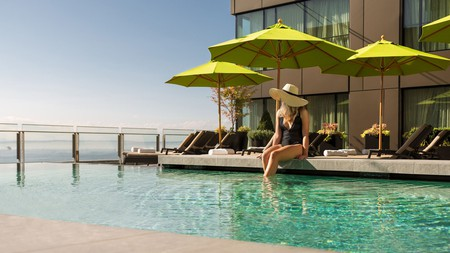 The rooftop infinity pool at Four Seasons Seattle features waterfront views