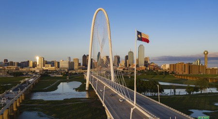 Explore the sights of Dallas, including the Margaret Hunt Hill Bridge, before checking into a cozy room
