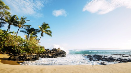 Hit the beach on a trip to Kauai with a stay at one the island's top beach hotels