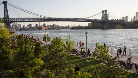 Domino Park is a great spot to stroll and take in the views of Brooklyn Bridge and Manhattan across the East River