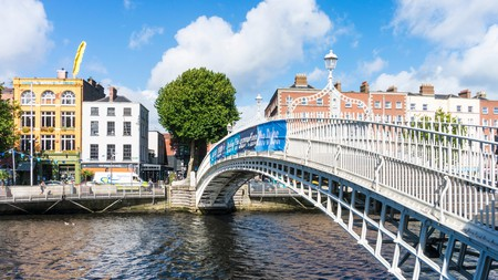 Cross the iconic Ha'penny Bridge over the River Liffey on a trip to Dublin