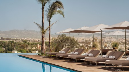 At the cool, modern Hotel Sahrai, you can enjoy views from the infinity pool to the jostling rooftops of the old medina of Fez