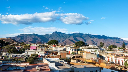 Enjoy cityscape views and scenery of the surrounding hills in Oaxaca, Mexico