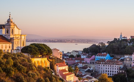 After a long day of sightseeing, relax in your own apartment and enjoy a view of Lisbon like this one – the Igreja de Convento da Graca at sunset