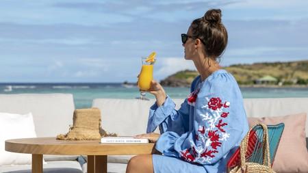 A guest enjoys a drink at Le Sereno resort