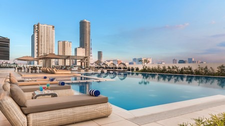 Enjoy the skyline view from the poolside loungers at the Seda Vertis North in Quezon City, the Philippines